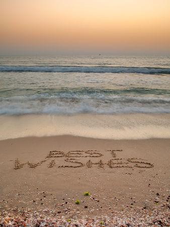 Sand writing - Best Wishes written on beach