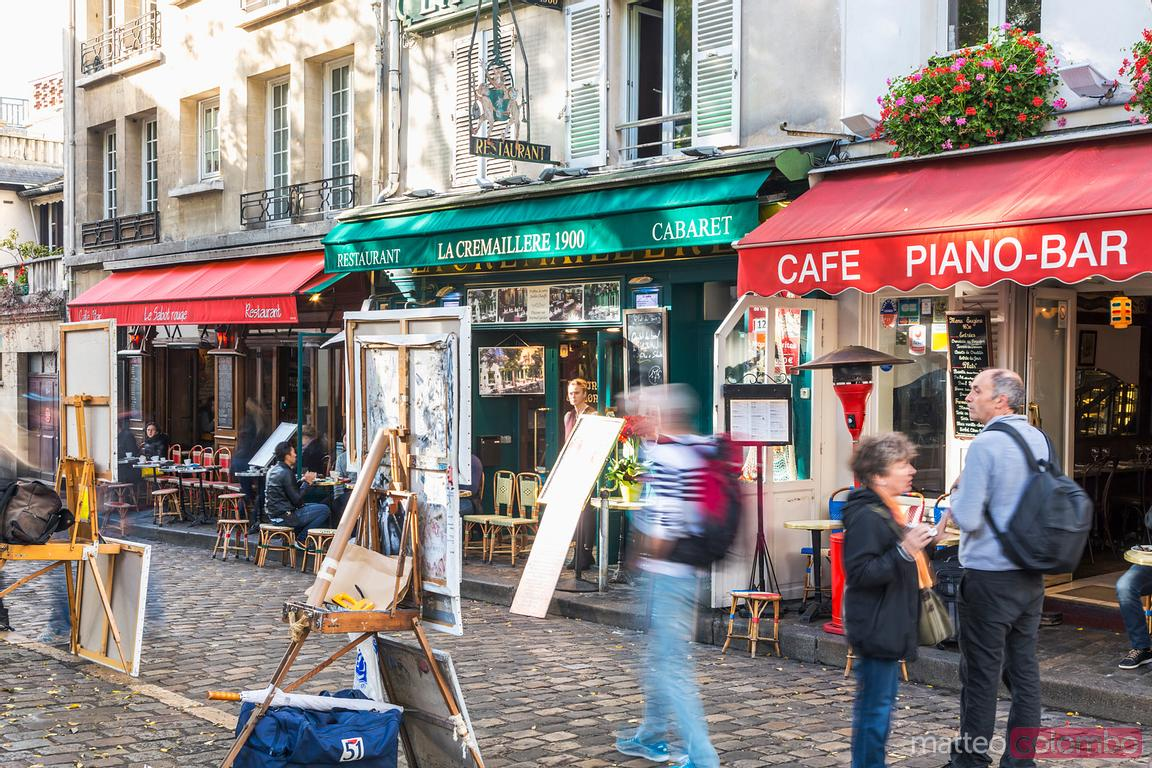 Tourists in the streets of Montmartre with artists, Paris, France