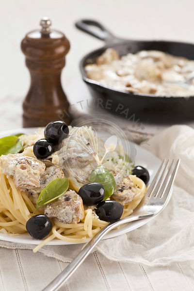 Spaghetti with cheese mushrooms sauce, olives and basil