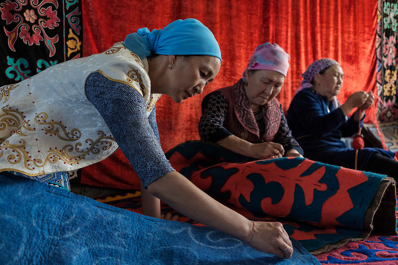 Kyrgyz Women Working on Traditional Felt Carpets