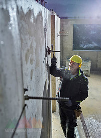 Construction worker fitting with hammer the iron rod