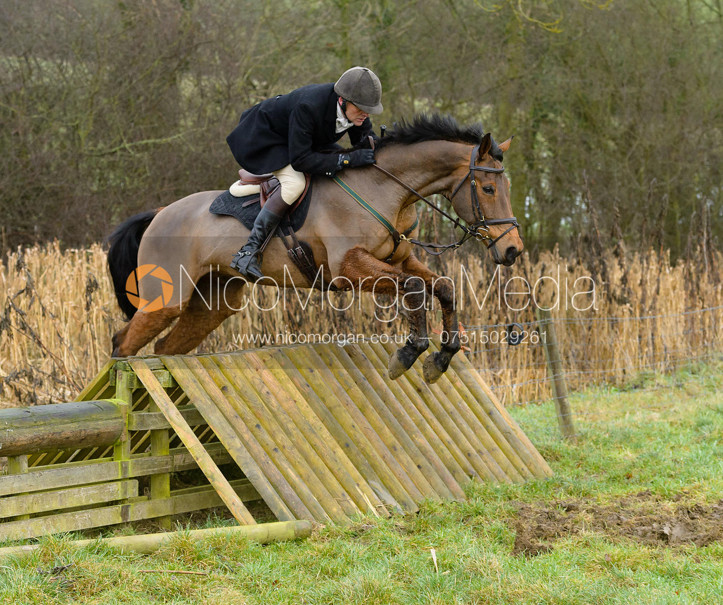 Charlie Smith jumping a hunt jump at Peakes - The Fitzwilliam Hunt visit the Cottesmore at Burrough House