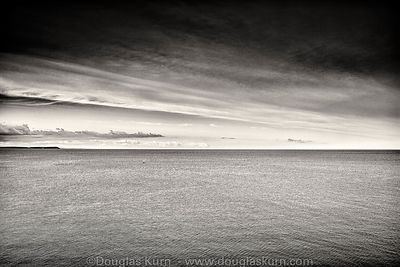 Limited edition Giclée fine art print of a yacht at sea under a big sky off the coast of Cornwall.