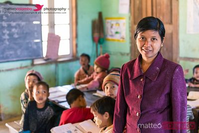 Teacher and children Inside a local primary school, Myanmar