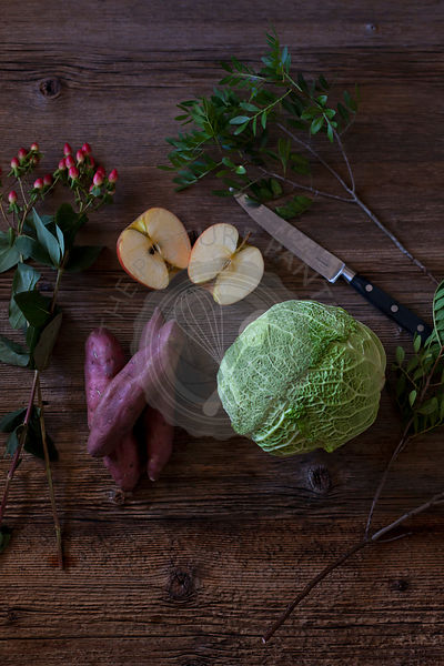 Cabbage salad ingredients on a wooden table