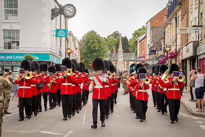 The Irish Guards were led by a Drum Major from the Coldstream Guards (Red plume in the bearskin as opposed to the Irish Guard...