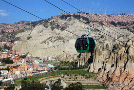 Green Line cable car gondola above Cementerio Jardin, El Alto in background, La Paz, Bolivia