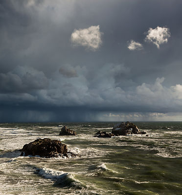 Dramatic stormy skies over rocky ocean on coast of San Francisco, USA