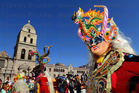 China Supay / female devil diablada dancer passing San Francisco church during the Gran Poder festival, La Paz, Bolivia