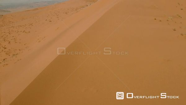 Aerial shot side of red sand dune to the top in desert landscape Botswana