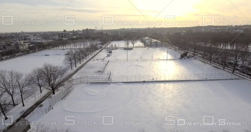 Aerial Snow Covered Soccer Football Fields Trees Silhouette Winter Day Brooklyn Prospect Park Sunset NYC