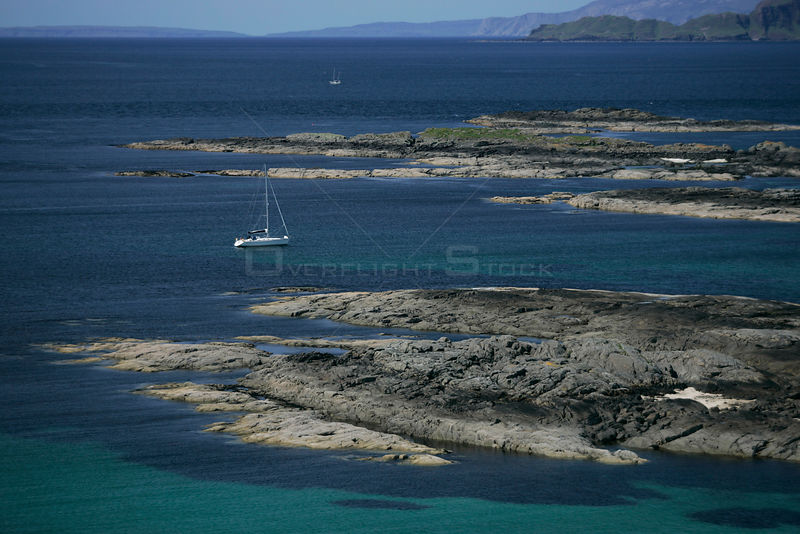 A yacht cruising the rugged Western Isles, Scotland. June 2005.