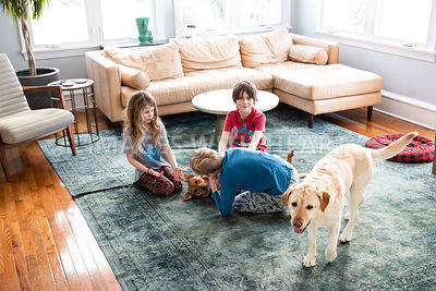 Three Kids Petting Dog
