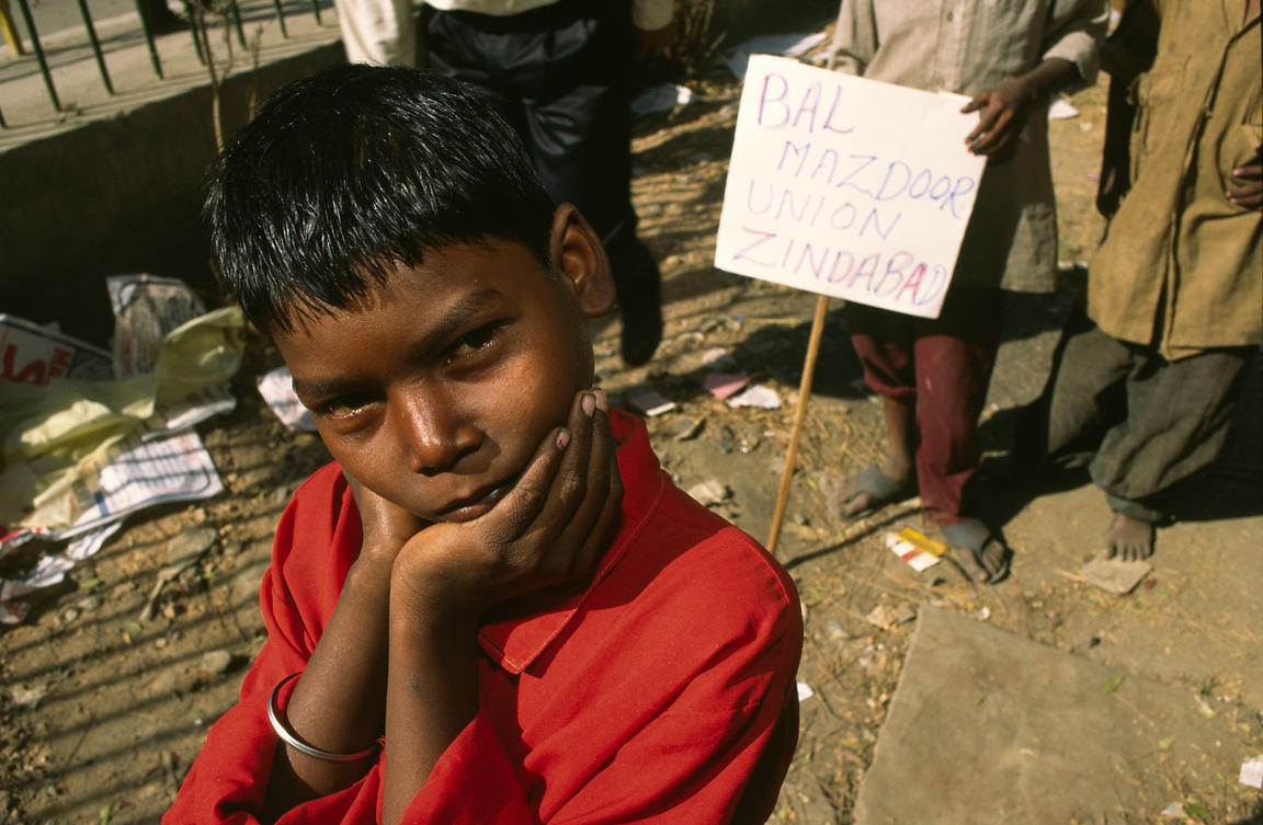 India - Delhi - A child worker at a demonstration