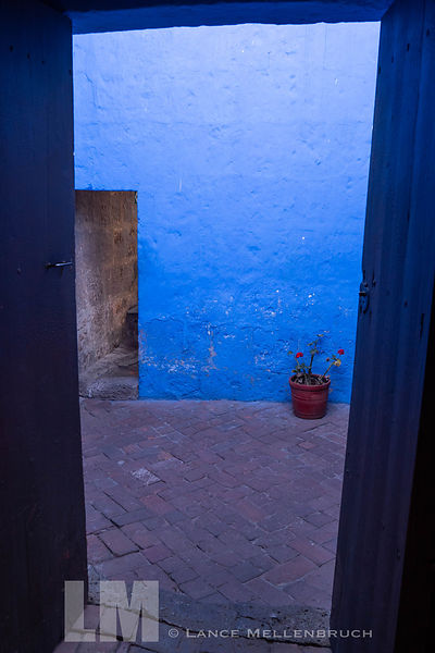Doorway to blue walled street at Monasterio de Santa Catalina
