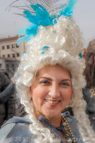 Smiling Woman Square posing in period costumes and white wigs at the Venice Carnival
