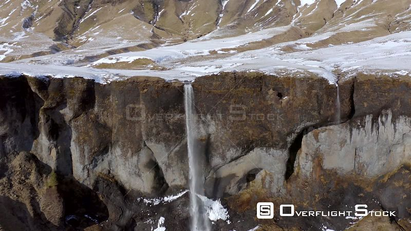 Small and Beautiful Waterfall on a Snowcapped Mountain in the Winter