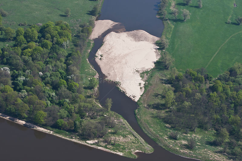 Sediment forming in the mouth of an oxbow lake. Elbe River, near Rosslau, Saxony-Anhalt, Germany, April 2012.