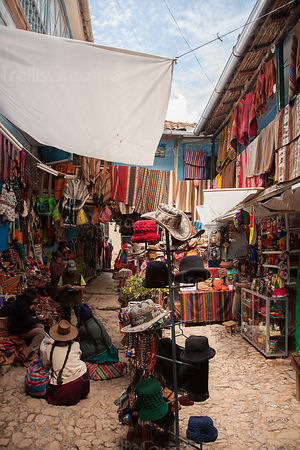 Local street vendors come to markets like this one to restock knit hats, gloves, blankets and other Peruvian  goods to sell t...