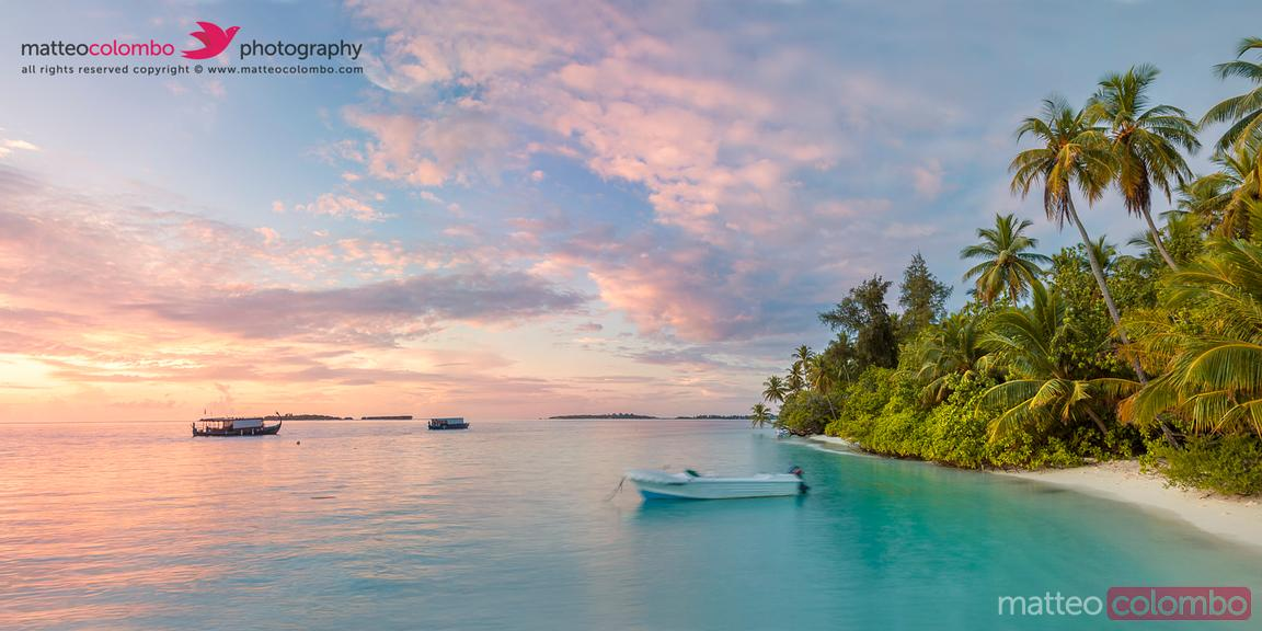 Panoramic of island and beach in the Maldives at sunset