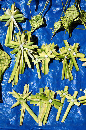 Crosses made out of palm leaves for sale on Palm Sunday , La Paz , Bolivia