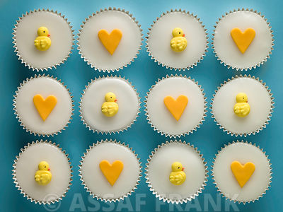 Cupcakes with chicks and heart shape decorations