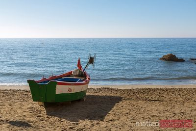 Wooden fishing boat at shore on a beach, Andalusia, Spain