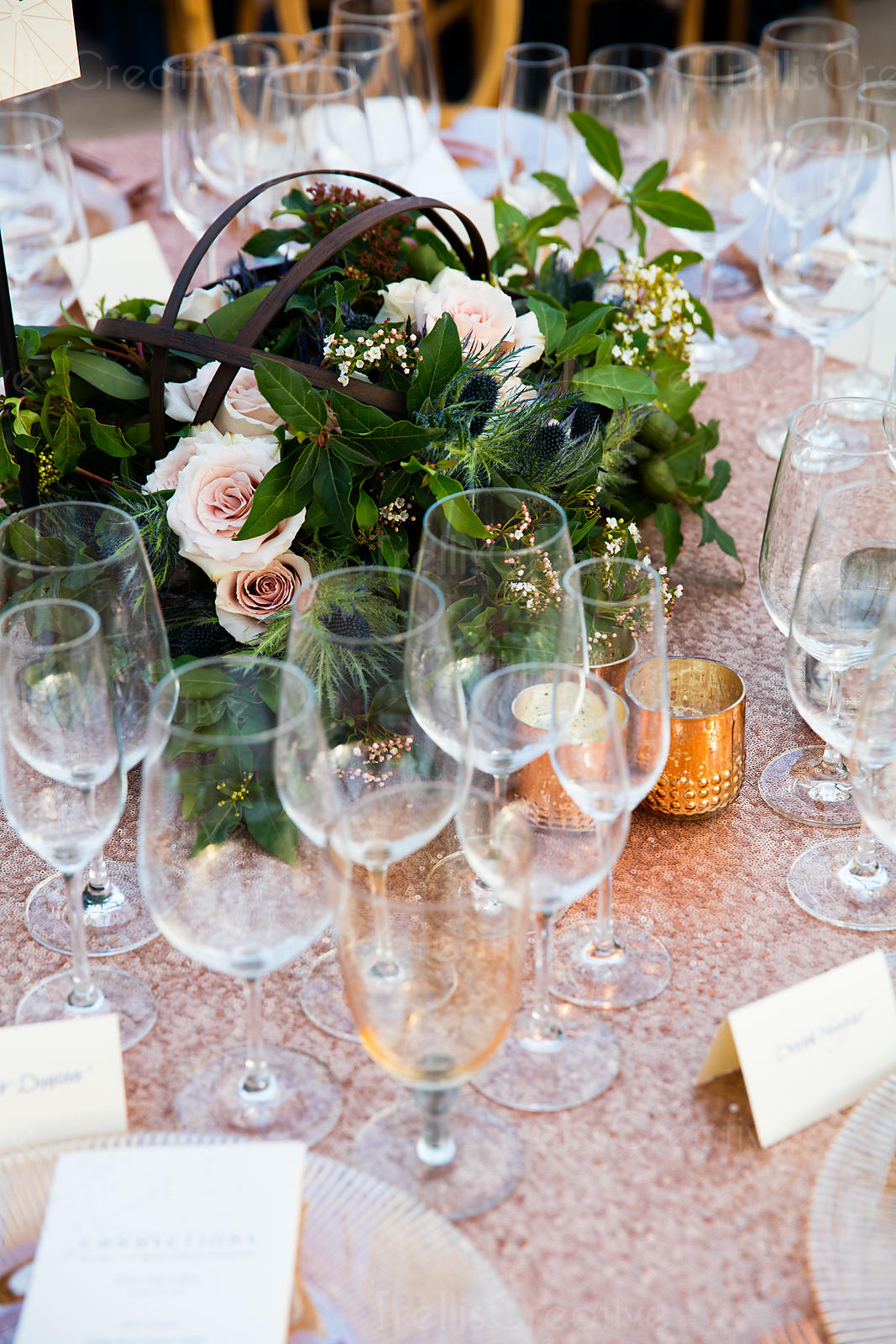 Wine glasses with bouquet on table at an event
