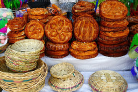 Loaves of bread and baskets for sale during Comadres festival, Tarija, Bolivia
