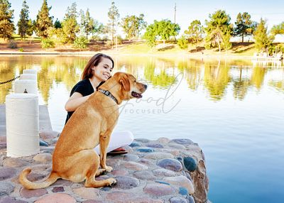 Girl and Dog at Lake in Park