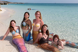 Mermaids gather in shallow water of Sand Dollar Beach, Highbourne Cay, Exuma Cays, Bahamas Islands during Mermaid Portfolio W...