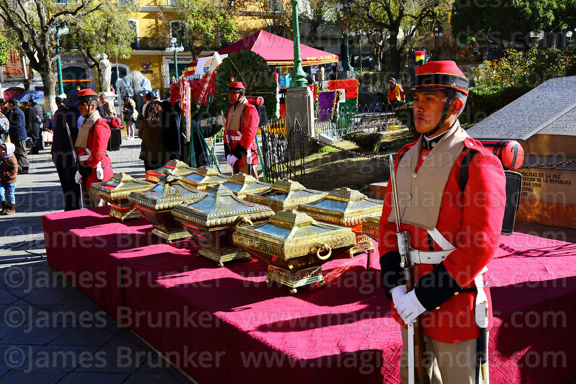 Members of the Los Colorados regiment guard caskets with the remains of members of the Junta Tuitiva in Plaza Murillo during ...