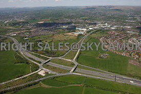 Rochdale high level wide angle aerial photograph looking across the M62 junction 20 motorway looking towards Rochdale