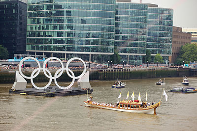 The Gloriana Carrying the Flame to the Olympic Rings