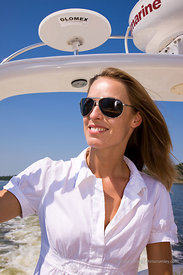 Model Virginie Leplus driving Sea Ray 340 in inland waters, Virginia Beach, VA