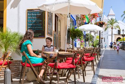 Outdoor cafe with tourists, Marbella, Andalusia, Spain