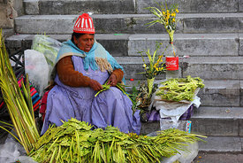 Aymara lady selling ornaments made out of palm leaves on Palm Sunday , La Paz , Bolivia