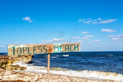 Topless Beach Sign in Mexico