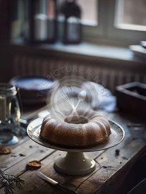Homemade bundt cake on a kitchen table. Front view