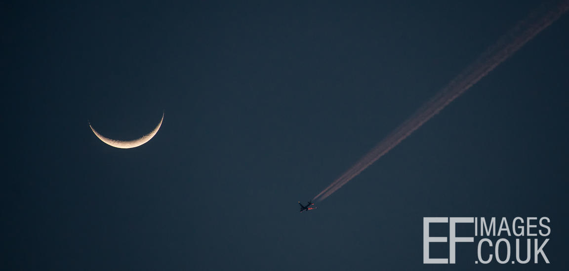 New Moon And Plane Catching The Last Light Of the Day