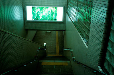 A poster of a traditional bamboo grove in a Kyoto subway corridor