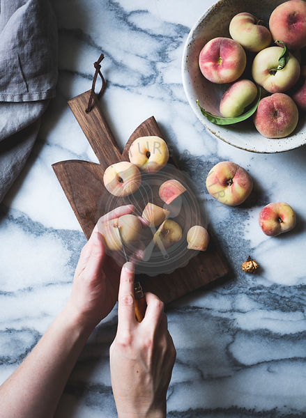 Peaches and chopping board