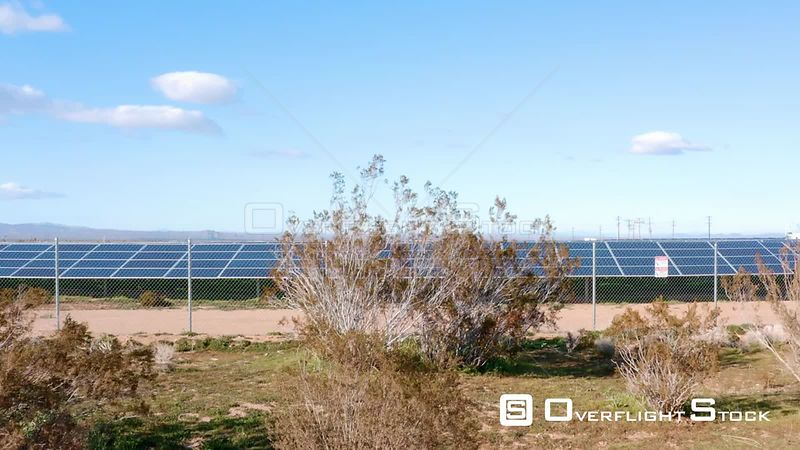 Ground Level Pop Up Reveal Then Pan Down To Endless Solar Panel Farm. California