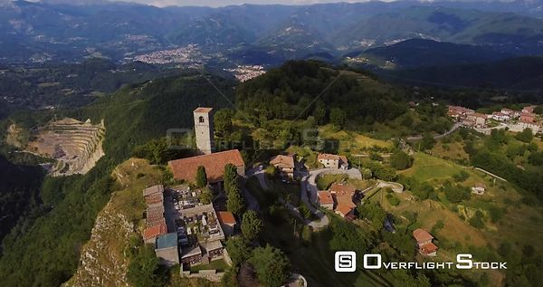 Aerial, medieval tower Rocca Di Sassi and a cemetery on top of the Apuan Alps in Tuscany, Italy