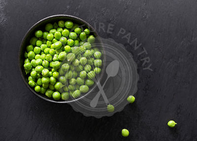 Raw green peas in a bowl.