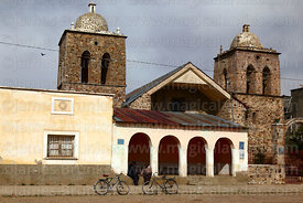 Men playing cards in archway in front of colonial church, Ayo Ayo, La Paz Department, Bolivia