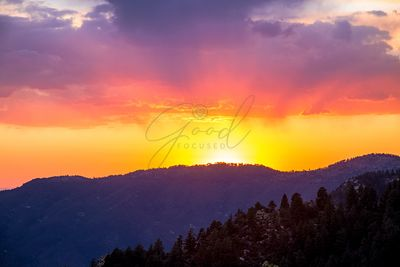 Colorful Sunset Over Mountain Range