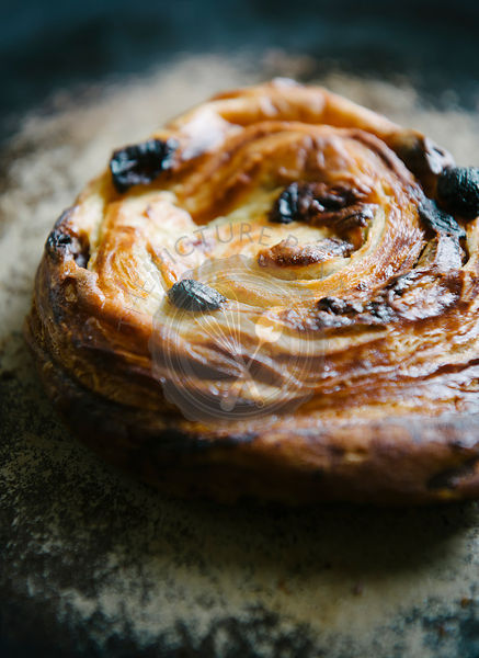 Pain aux raisins breakfast pastry. A breakfast food often eaten in France that is directly translated to raisin bread.