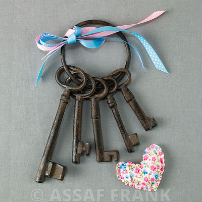 Old keys on a key ring with Ribbons and a heart