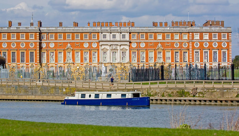 Narrow Boat Sailing past Hampton Court Palace on the Thames